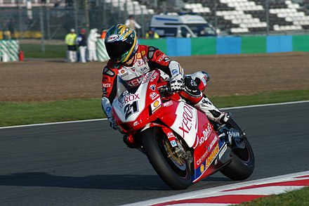 Troy Bayliss has won the Superbike World Championship a record three times with Ducati after Carl Fogarty. Troy Bayliss SBK 2006.jpg