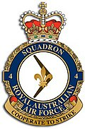 "Crest of 4 Squadron, Royal Australian Air Force, featuring a fleur-de-lis on a boomerang and the motto ""Cooperate to Strike"""