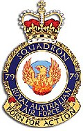 "Crest of 79 Squadron, Royal Australian Air Force, featuring a phoenix and the motto ""Born for Action"""