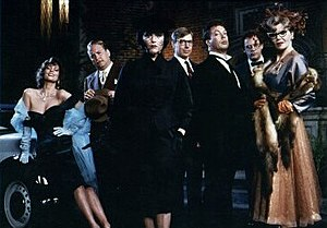 Clue (film) - left to right: Miss Scarlet (Lesley Ann Warren), Colonel Mustard (Martin Mull), Mrs. White (Madeline Kahn), Mr. Green (Michael McKean), Wadsworth (Tim Curry), Professor Plum (Christopher Lloyd), and Mrs. Peacock (Eileen Brennan)
