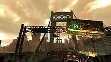 "A sign hangs over a bridge with the words ""Welcome to The Pitt"""