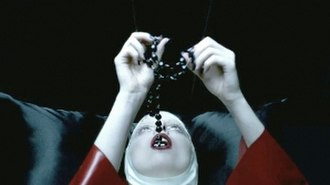 Alejandro (song) - Lady Gaga dressed as a nun in a red latex habit, swallowing rosary beads