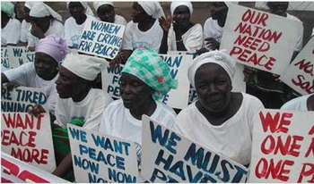 Women of Liberia Mass Action for Peace - Women dressed in white holding signs in protest