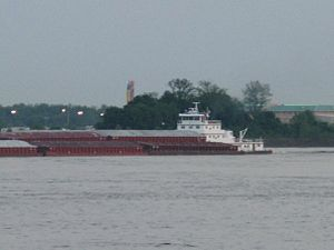Helena–West Helena, Arkansas - Barges traveling north on the Mississippi River pass the Helena river park