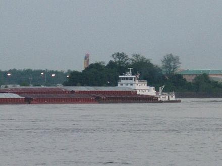 Barges traveling north on the Mississippi River pass the Helena river park MississippiRiverActivityfromHelena.jpg
