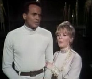 Petula Clark - Clark holding Belafonte's arm, the first scene of physical contact between a black man and a white woman to appear on US television, April 1968
