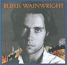 "Black and white head shot of a man; in the background is a colorful collage and the text ""Rufus Wainwright"" appears across the top"