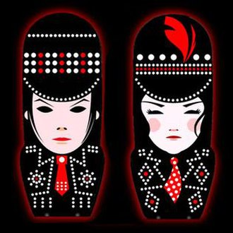 Icky Thump - The USB drive album artwork for Icky Thump, stylized illustrations of Jack (left), and Meg (right). The hats are the covers to the drives.