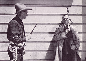 Bee Ho Gray - Bee Ho Gray throwing knives at Erich von Stroheim on the set of Greed.