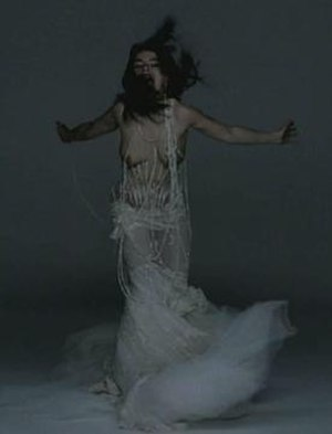 Pagan Poetry - Björk wearing an in-body-pierced-wedding dress designed by English fashion designer Alexander McQueen in the Pagan Poetry music video.