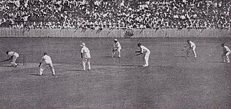 Harold Larwood - The bodyline strategy in action: Woodfull (extreme left) ducks under a ball, while five fielders wait on the leg side. The wicket-keeper, Leslie Ames, is centre picture; Jardine is third from right