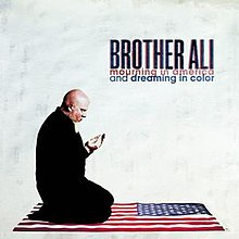 [Image: 220px-Brother-ali-mourning-in-america-dr...colour.jpg]