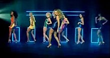 Knowles dancing with several background female dancers in a studio