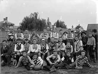 History of Australian rules football in Victoria (1859–1900) - A Geelong junior team. Note the variety of jumpers. Nevertheless, there a good number of players wearing horizontal stripes, presumably in the Geelong colours of blue and white.