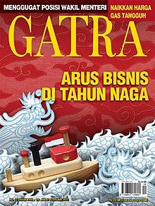 Red magazine cover depicting toy boat in stylized sea made of dragons, with GATRA printed in large letters across the top