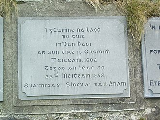 Dunboy Castle - Plaque on castle wall. Translation from Irish: 'In memory of the heroes who fell in Dunboy on behalf of country and faith in June 1602. May their souls rest in peace.'