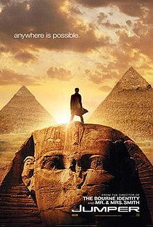 "Movie poster with the Egyptian Sphinx monument at the bottom of the image and two pyramids visible in the background. A man is standing on top of the Sphinx's head, facing forward. Sunlight behind him makes it difficult to see most details. The sky has multiple clouds, and at the top of the image is the tagline ""anywhere is possible."" At the bottom of the image is the film's title and website for the film."