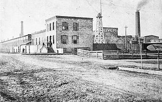 Oliver Farm Equipment Company - The entrance to the Oliver Chilled Plow Works in South Bend, Indiana, c.1880.