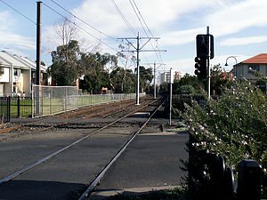 Port Melbourne railway line - Looking towards Port Melbourne from the Swallow Street level crossing, the railway signals have been removed and have been replaced with signals resembling traffic signals for the trams