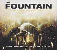 "A photograph of Hugh Jackman as the Last Man from The Fountain being incinerated by the heart of a dying star in outer space. At the top of the cover is written ""THE / FOUNTAIN / MUSIC FROM THE MOTION PICTURE"" in black and gold. At the bottom is written ""A FILM BY DARREN ARONOFSKY • MUSIC BY CLINT MANSELL"" in white."