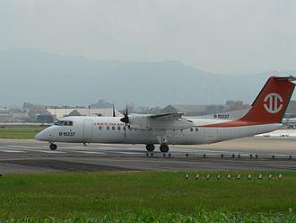 Uni Air - A Uni Air Dash 8 preparing to take off in Taipei Songshan Airport