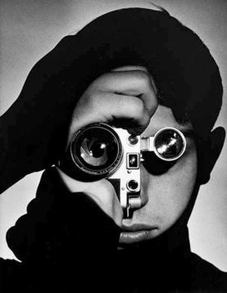 """Andreas Feininger - """"The Photojournalist"""", showing the photojournalist Dennis Stock, may be Feininger's best-known photograph; he took it for Life in 1951."""