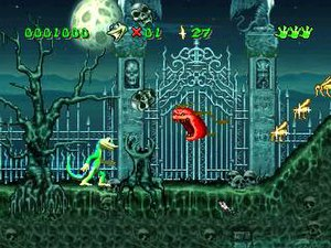 Gex (video game) - Gex in a horror level. The jumping tomato is an enemy. The features in the display bar, from left to right, are the player's score, number of lives, number of flies, and health.