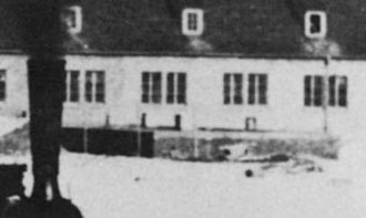 Criticism of Holocaust denial - Detail of a photograph taken at Auschwitz between February 9 and 11, 1943, showing the gas chamber at Crematorium Complex II, then under construction. Some of the apertures through which Zyklon B was inserted into the gas chamber are visible.