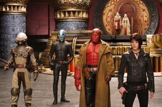 Hellboy II: The Golden Army - Foreground, From left to right: Johann Krauss, Abe Sapien, Hellboy, and Liz Sherman; Background: Prince Nuada, Princess Nuala