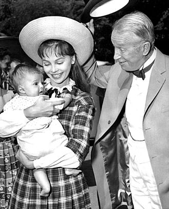 Leslie Caron - Candid photo with her new son, Christopher, and co-star Maurice Chevalier on the set of Gigi (1958)