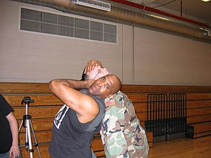 Virgil (wrestler) - Jones posing with a U.S. Soldier by demonstrating a neckbreaker