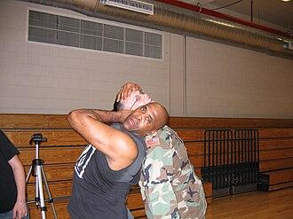 Virgil (wrestler) - Jones posing with a U.S. Soldier by demonstrating a neckbreaker