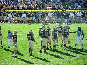 2005 Notre Dame Fighting Irish football team - Brady Quinn and the offense, donning the green jerseys, line up for a play