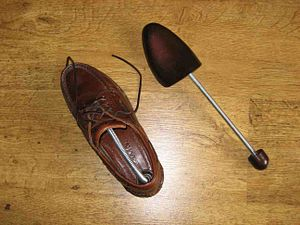 Shoe tree - A pair of shoe trees, one shown in use