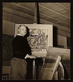 Carl Holty with painting.jpg