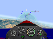 A first-person cockpit view of a simulated airplane; dials and gauges take up the bottom half of the image. The ground and blue sky extend into the distance, and a hill is visible below. Rings of geometric shapes and a wireframe airplane model are in the sky ahead.