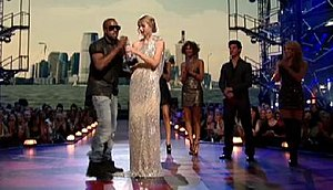2009 MTV Video Music Awards - West taking the microphone from Swift at the 2009 MTV Video Music Awards.