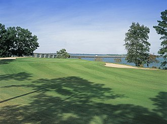 Santee, South Carolina - The 18th hole at the Santee-Cooper Country Club, showing the I-95 causeway crossing Lake Marion at Santee