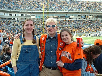 "Virginia Pep Band - The principal players in the Continental Tire Bowl Show, including a ""West Virginia Student"" (left), ""The Bachelor"" (center), and a""UVa Student"" (right)."