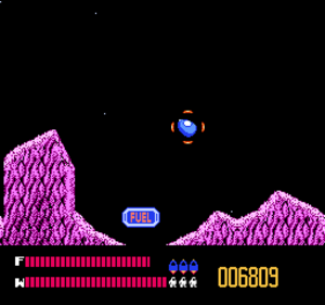Solar Jetman - A still image of gameplay. Jetman must manoeuvre his pod through various planets with ranging gravitational pulls