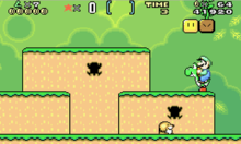 This screenshot shows Luigi riding Yoshi during one of the game's early stages in the Game Boy Advance version. The scenery shows a jungle environment with floating blocks scattered in the air. The interface displayed along the top of the image shows the number of lives, point multiplier, special item, time remaining, number of coins and total score.