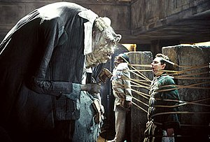 Vogon - Prostetnic Vogon Jeltz of the Galactic Hyperspace Planning Council tortures Ford Prefect and Arthur Dent with his poetry in the 2005 film The Hitchhiker's Guide to the Galaxy.