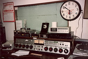 "WPGB - WYDD on-air studio at 810 Fifth Avenue in New Kensington from the early 1970s until 1989, when this studio was converted to production use only. Note the WYDD ""Heartbeat"" logo from the early 1980s on the clock's face. WYDD had switched its call letters to WNRJ and moved into a more state-of-the-art studio that year. The studios were finally moved to Greentree in 1991."