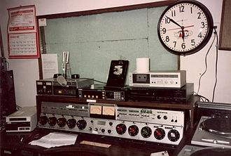 """WPGB - WYDD on-air studio at 810 Fifth Avenue in New Kensington from the early 1970s until 1989, when this studio was converted to production use only. Note the WYDD """"Heartbeat"""" logo from the early 1980s on the clock's face. WYDD had switched its call letters to WNRJ and moved into a more state-of-the-art studio that year. The studios were finally moved to Greentree in 1991."""