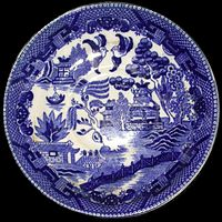 A blue and white Willow pattern plate