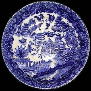 Willow pattern distinctive and elaborate chinoiserie pattern, primarily used on pottery