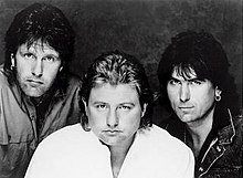 Emerson, Lake & Powell, 1986. L-R: Keith Emerson, Greg Lake, and Cozy Powell.
