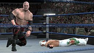 WWE SmackDown vs. Raw 2008 - Kane wrestles Rey Mysterio (this is an early screenshot; Rey Mysterio's attire was changed from white to black).
