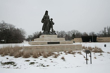 The Pioneer Woman statue was modeled by sculptor Bryant Baker and was unveiled in a public ceremony on April 22, 1930, when forty thousand guests came to hear Will Rogers pay tribute to Oklahoma's pioneers. The statue is 27 feet (8.2 m) high and weighs 12,000 pounds. Pioneer Woman in Winter.jpg