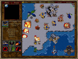 Warcraft II: Tides of Darkness - In the largest area of the screen, to the right, the Orcs (the player's, in blue) attack a Human town and its defenders (red). The flaming buildings are close to collapse, and the burnt ground to their right is the remains of a razed building. This is a winter map, and the ice enables ground units to walk over the shallow part of the sea.